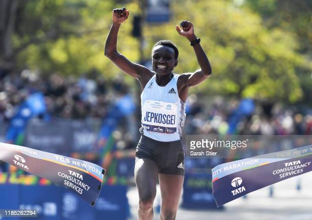 Joyciline Jepkosgei of Kenya reacts as she crosses the finish line to win the Women's Division of the 2019 TCS New York City Marathon on November 03...
