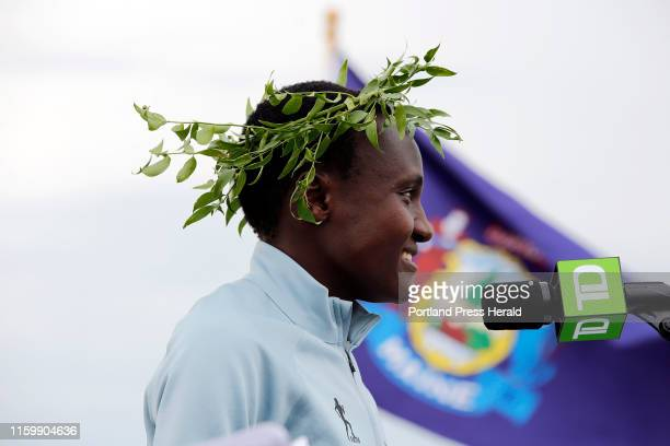 Joyciline Jepkosgei of Kenya speaks during there winners' ceremony after the TD Beach to Beacon 10K Road Race Jepkosgei win the women's division with...