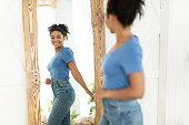 Joyful African American Girl After Slimming Looking In Mirror Indoor