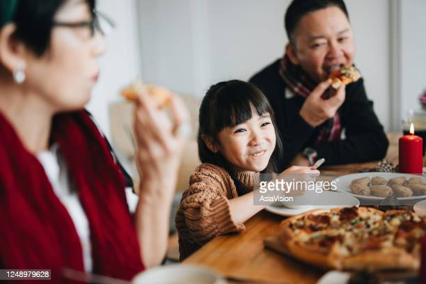joyful asian multi generation family celebrates christmas and spending time together enjoying christmas party at home - tradition stock pictures, royalty-free photos & images