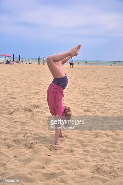 joyful beach gymnastics - michael stock photos and pictures