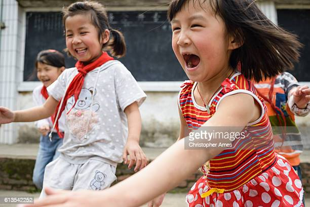 Joyful Chinese Elementary School Kids Playing Outdoors