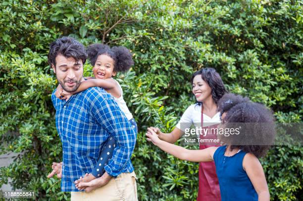 joyful family with two children enjoying together in the park. - life insurance stock pictures, royalty-free photos & images