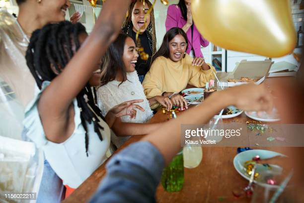joyful friends celebrating birthday in party - focus on background stock pictures, royalty-free photos & images