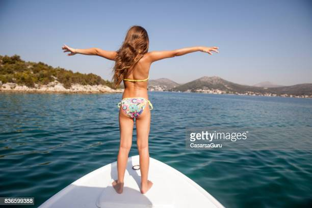 joyful girl on summer holiday standing on  bow and enjoy the view - only girls stock pictures, royalty-free photos & images
