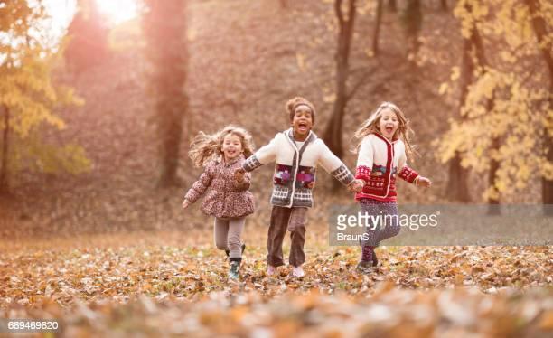 joyful girls running and screaming in the park. - in the park day 3 imagens e fotografias de stock