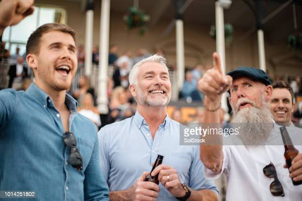 joyful men at the races - horse racing stock pictures, royalty-free photos & images