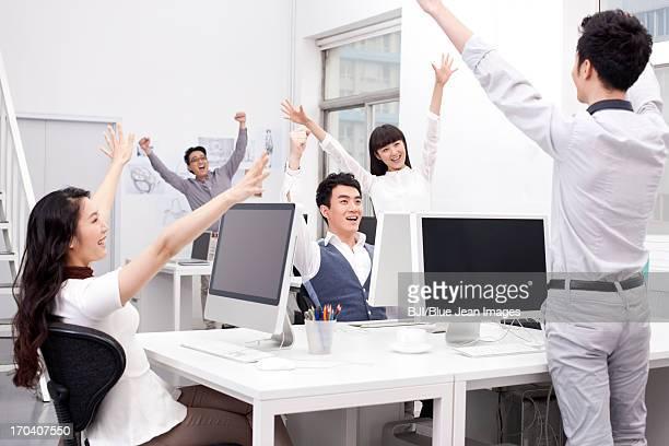 Joyful office workers celebrating