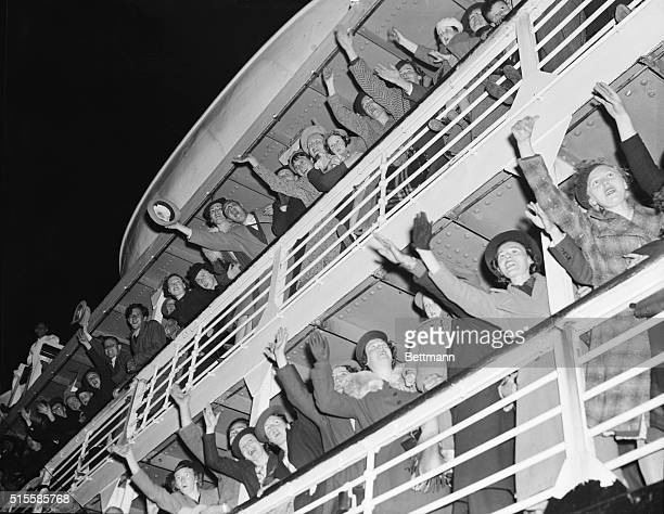 Joyful passengers wave from the ocean liner Iroquois that was threatened when it crossed the Atlantic ocean during World War II.
