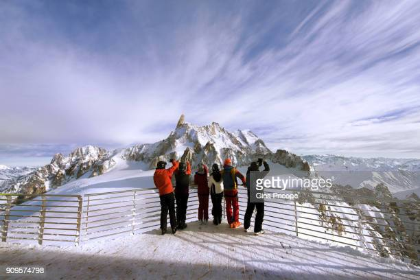 joyful tourists on the terrace punta helbronner in courmayeur italy. - クールマイヨール ストックフォトと画像