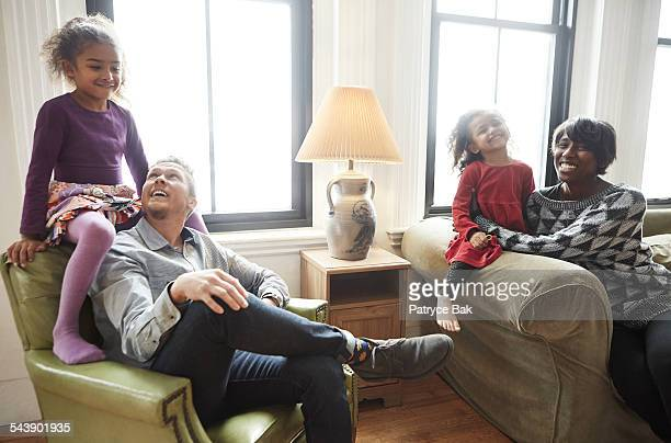 Joyful transgender dad with daughters and wife
