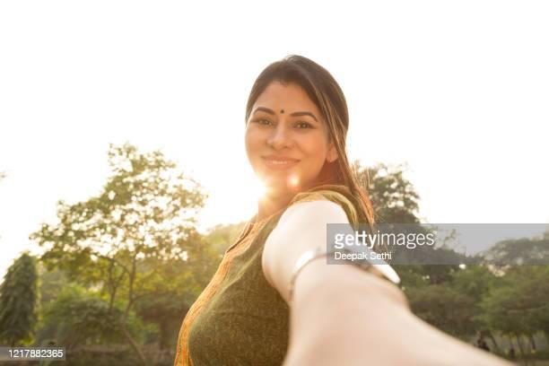 joyful woman enjoying the freedom stock photo - india summer stock pictures, royalty-free photos & images
