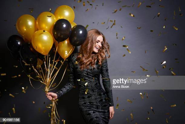 Joyful woman with bunch of balloons. Debica, Poland