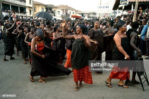 Joyful women dancing in the streets of Kumasi on the occasion of the coronation of the new Ashanti King, Otumfuo Osei Tutu II, Ashanti Region of...