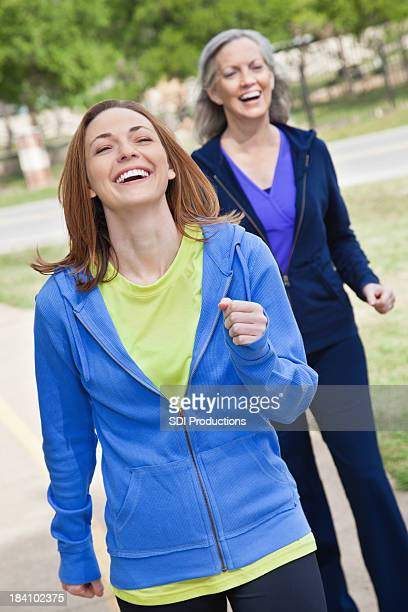 Joyful Women Exercise Walking Outside on Trail