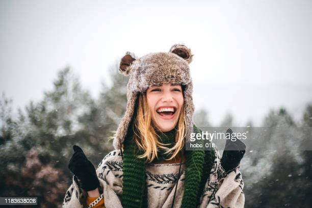 joyful young woman enjoys cold winter day in mountains - winter stock pictures, royalty-free photos & images