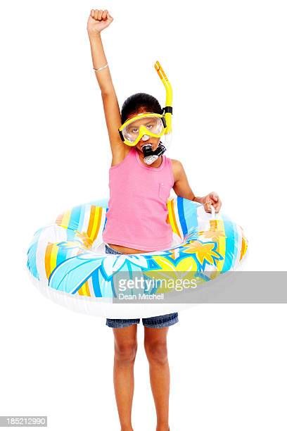 Joyous little girl wearing snorkeling gear standing on white