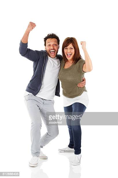Joyous mature couple celebrating success