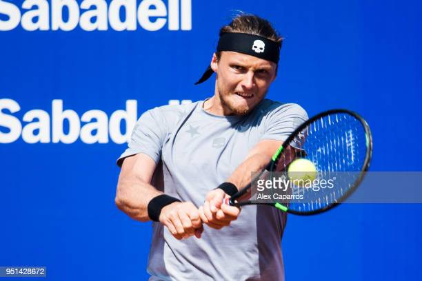Jozef Kovalik of Slovakia plays a backhand against Dominic Thiem of Austria in their match during day four of the Barcelona Open Banc Sabadell on...