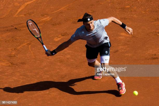 Jozef Kovalik of Slovakia plays a forehand against Dominic Thiem of Austria in their match during day four of the Barcelona Open Banc Sabadell on...