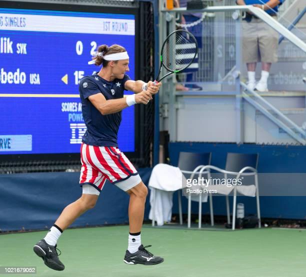 Jozef Kovalik of Slovakia returns during qualifying day 2 against Ernesto Escobedo of USA at US Open Tennis championship at USTA Billie Jean King...