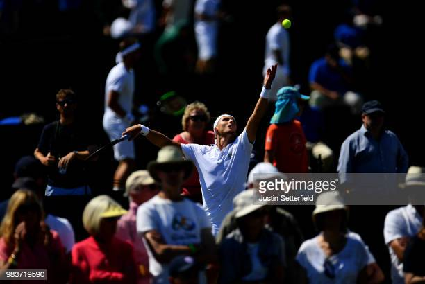 Jozef Kovalik of Slovakia serves against Jurgen Melzer of Austria during the Wimbledon Lawn Tennis Championships Qualifying at The Bank of England...
