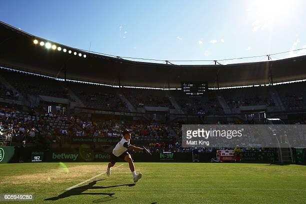 Jozef Kovalik of Slovakia serves in his singles match against Bernard Tomic of Australia during the Davis Cup World Group playoff between Australia...