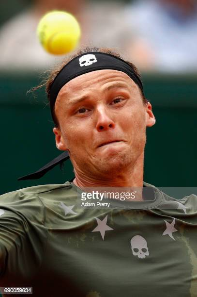Jozef Kovalik of Slovakia watches the flight of the ball during the mens singles first round match against Stan Wawrinka of Switzerland on day three...