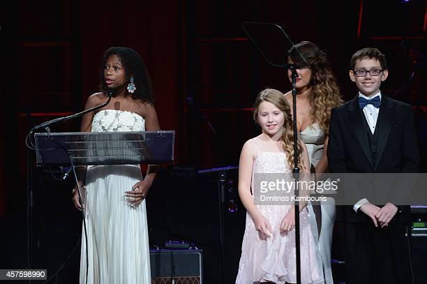 Jozlyn Arabelle and Jaiman of Children's National Health System speak onstage during Angel Ball 2014 hosted by Gabrielle's Angel Foundation at...