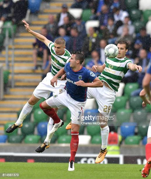Jozo Simunovic and Erik Sviatchenko of Celtic and Andrew Waterworth of Linfield during the Champions League second round first leg qualifying game...