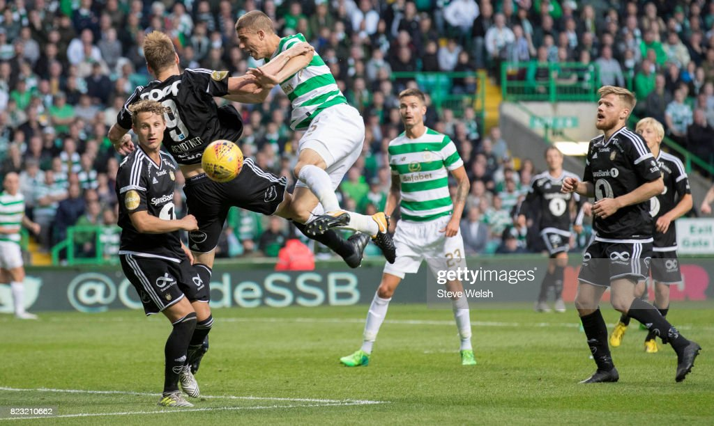 Jozo Simunovic of Celtic clatters into Nicklas Bendtner of Rosenborg during the UEFA Champions League Qualifying Third Round,First Leg match between Celtic and Rosenborg at Celtic Park Stadium on July 26, 2017 in Glasgow, Scotland.