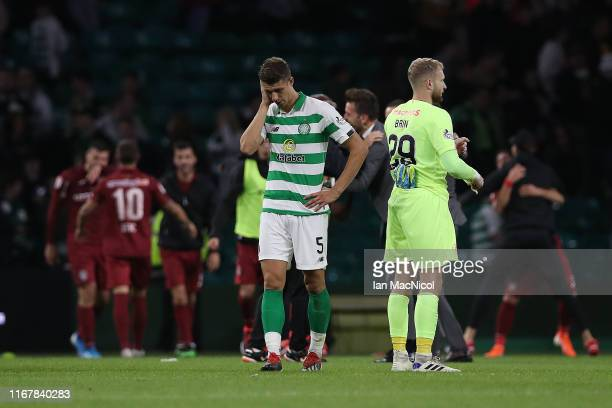 Jozo Simunovic of Celtic reacts at full time during the UEFA Champions League third qualifying round second leg match between Celtic and CFR Cluj at...