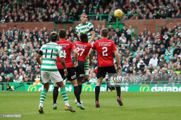Jozo Simunovic of Celtic scores his team's first goal during the Ladbrokes Scottish Premiership match between Celtic and Kilmarnock at Celtic Park on...