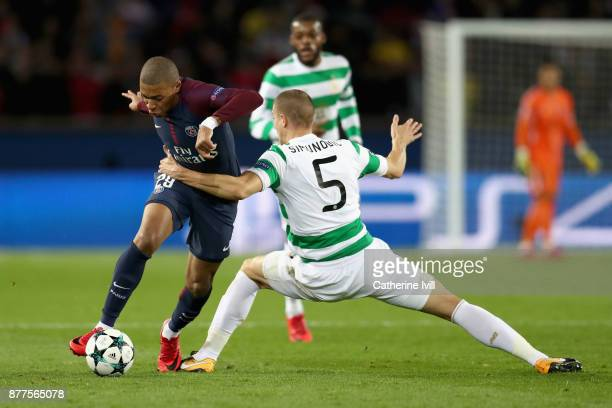 Jozo Simunovic of Celtic tackles Kylian Mbappe of PSG during the UEFA Champions League group B match between Paris SaintGermain and Celtic FC at Parc...