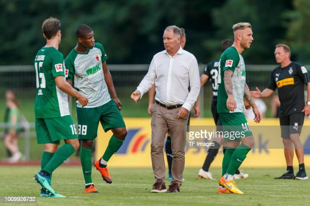 Jozo Stanic of FC Augsburg Kevin Danso of FC Augsburg and Stefan Reuter of FC Augsburg look on during the Friendly match between Borussia...