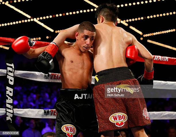 Jozsef Ajtai left is pinned to the ropes by Zou Shiming in their Flyweight Championship bout on June 11 2016 at the Theater at Madison Square Garden...