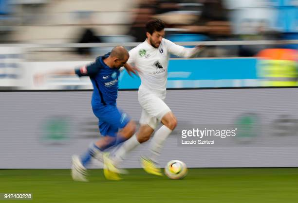 Jozsef Kanta of MTK Budapest competes for the ball with Daniel Nagy of Ujpest FC during the Hungarian Cup Quarter Final 2nd Leg match between MTK...