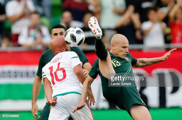 Jozsef Varga of Hungary competes for the ball with Aaron Mooy of Australia during the International Friendly match between Hungary and Australia at...