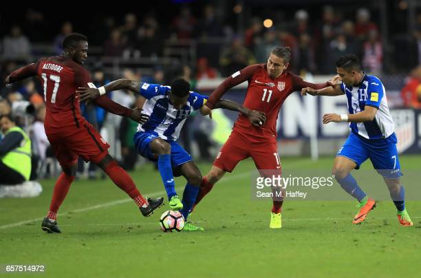 Jozy Altidore and Alejandro Bedoya of the United States defend against Romell Quioto and Romell Quioto of Honduras during their FIFA 2018 World Cup...