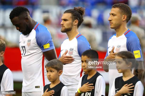 Jozy Altidore, Graham Zusi and Fabian Johnson of the United States look on during the national anthem before the game against Costa Rica during the...