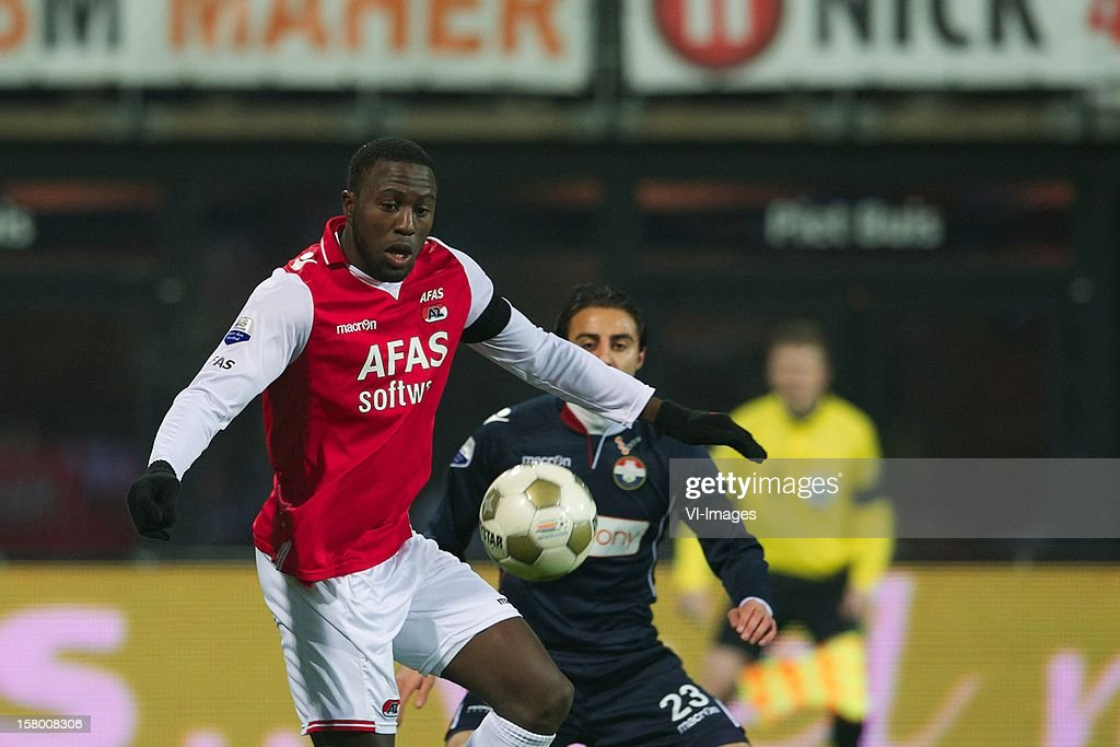 Jozy Altidore of AZ, Gaby Jallo of Willem II during the Dutch Eredivisie match between AZ Alkmaar and Willem II at the AFAS Stadium on December 08, 2012 in Alkmaar, The Netherlands.
