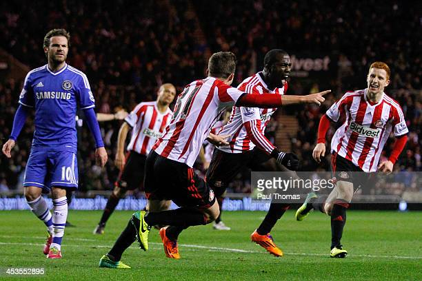 Jozy Altidore of Sunderland celebrates with teammates after scoring the opening goal of the Barclays Premier League match between Sunderland and...