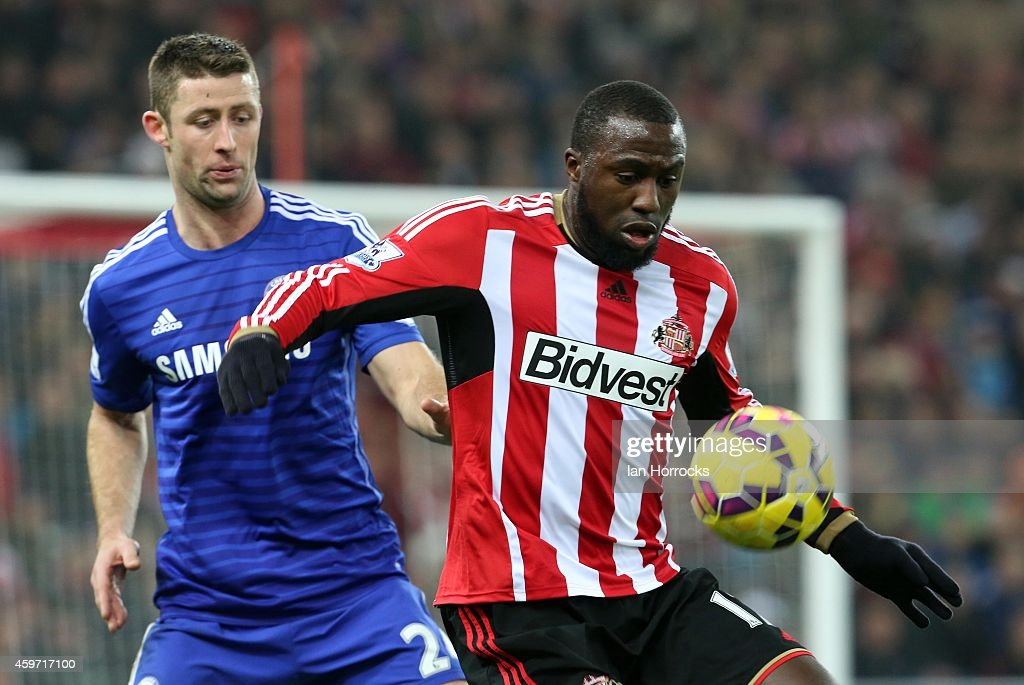 Jozy Altidore of Sunderland (R) is shadowed by Gary Cahill of Chelsea during the Barclays Premier League match between Sunderland AFC and Chelsea at the Stadium of Light on November 29, 2014 in Sunderland, England.