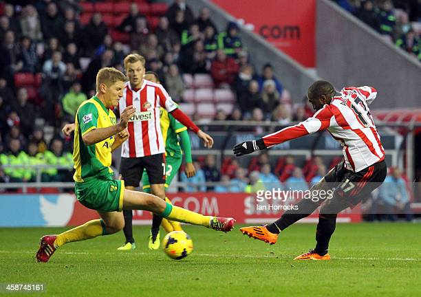 Jozy Altidore of Sunderland shoots on goal with Michael Turner of Norwich City trying to block the shot during the Barclays Premier League match...