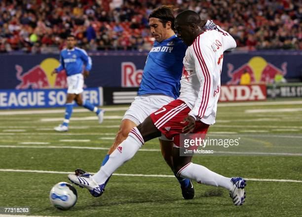 Jozy Altidore of the New York Red Bulls battles for the ball against Nick Garcia of the Kansas City Wizards on October 13 2007 at Giants Stadium in...