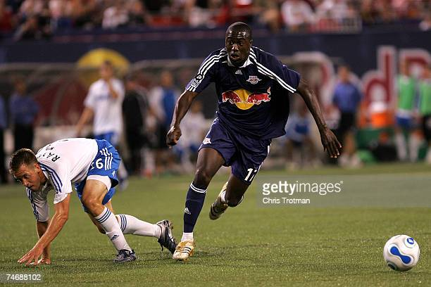 Jozy Altidore of the New York Red Bulls battles for the ball with Ryan Raybould of the Kansas City Wizards at Giants Stadium in the Meadowlands June...