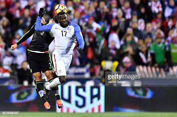 Jozy Altidore of the United States and Carlos Salcedo of Mexico jump for a header in the second half during the FIFA 2018 World Cup Qualifier at...
