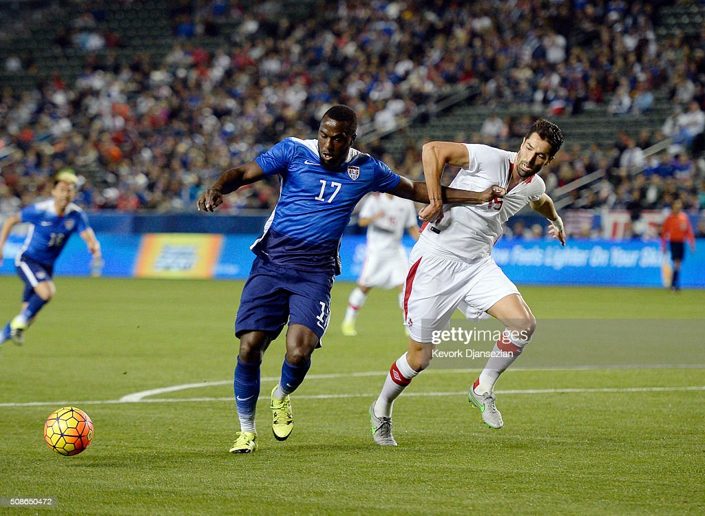 Jozy Altidore #17 of the United States battles with Steven Vitoria #15 of Canada during the first half of their international friendly soccer match at StubHub Center February 5, 2016 in Carson, California.