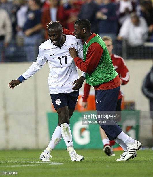 Jozy Altidore of the U.S. Is congratulated by teammate Maurice Edu after scoring three goals against Trinidad and Tobago during a FIFA 2010 World Cup...