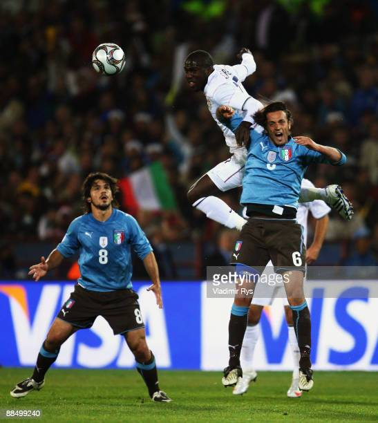 Jozy Altidore of the USA and Nicola Legrottaglie of Italy vie for a header as his team mate Gennaro Gattuso looks on during the FIFA Confederations...